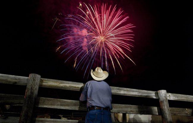 Cowboy watches fireworks