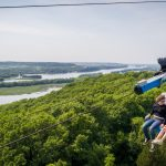 Two people ziplining at Chestnut Mountain Resort above the Mississippi RIver