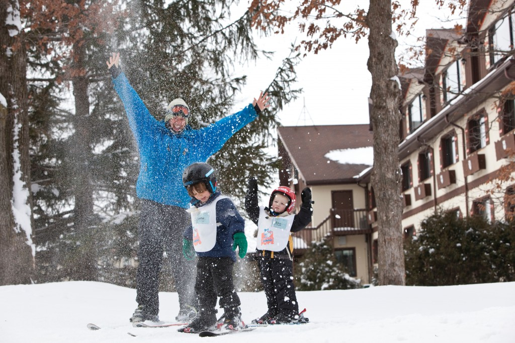 Family throwing snow in the air