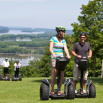 2 men riding segways on a mountain